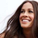 Alanis Morissette smiling at the sky.