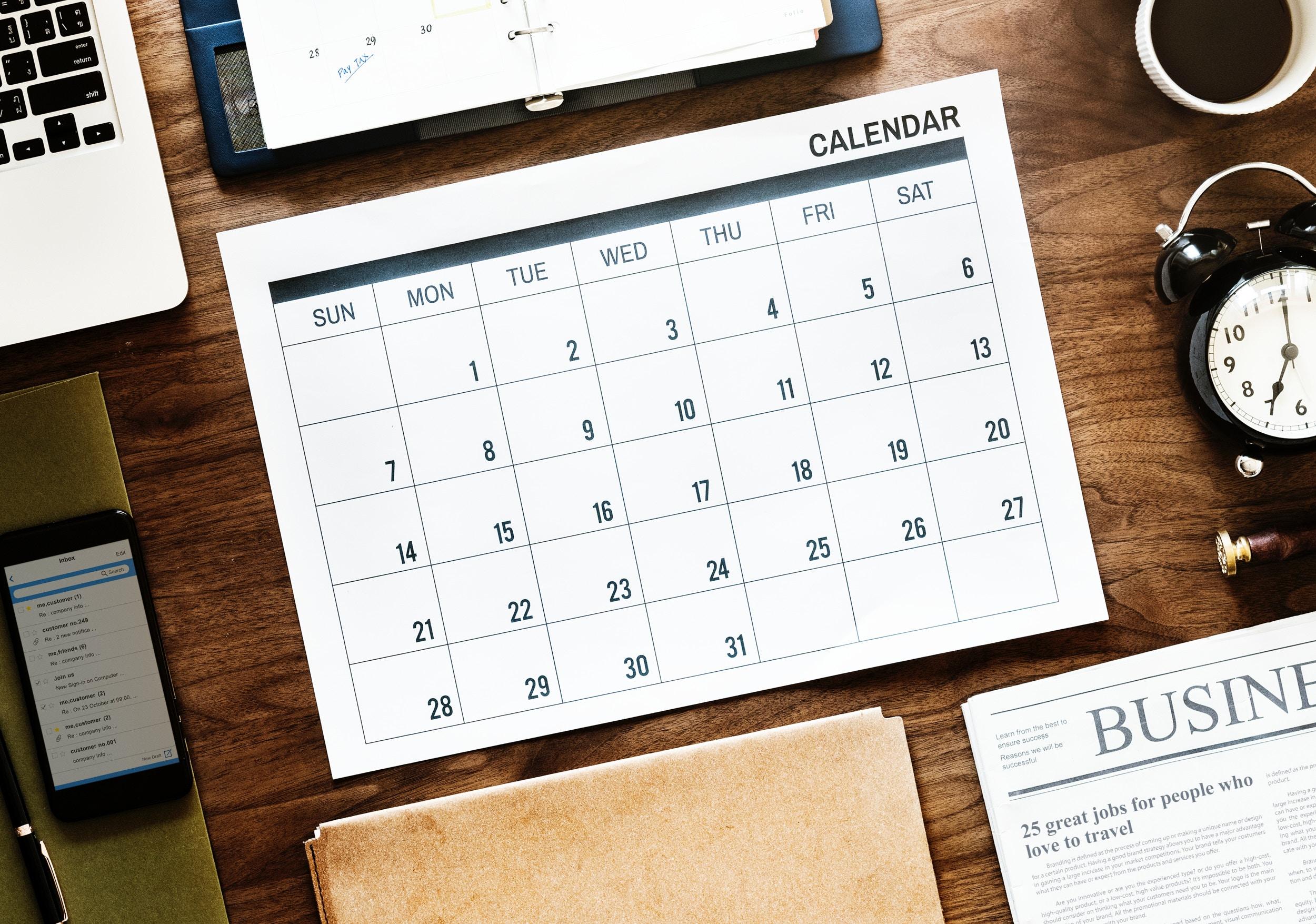 A calendar on a wooden desk.