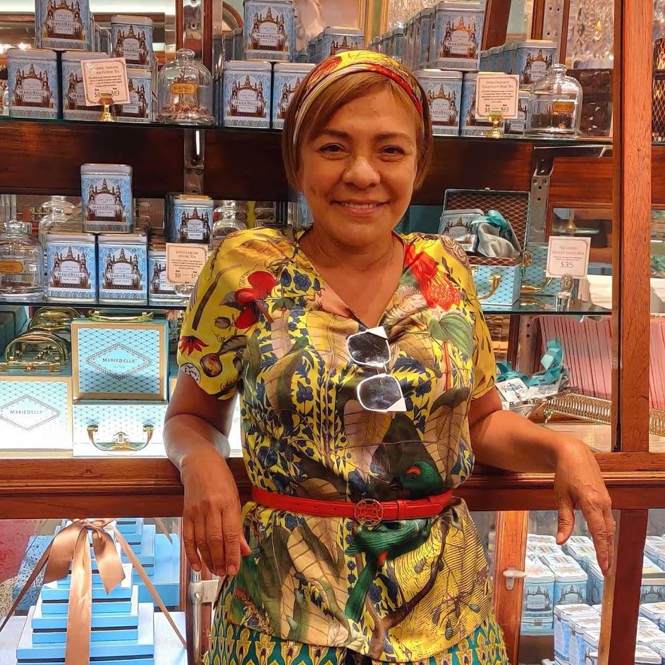 Maribel Lieberman in a yellow dress in her store