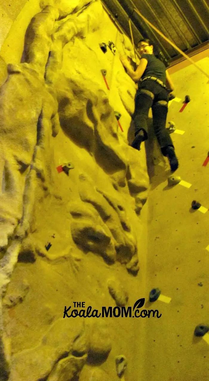 Reaching the top of the rock climbing wall