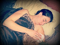 Bonnie Way with her new baby, recovering in bed after her homebirth