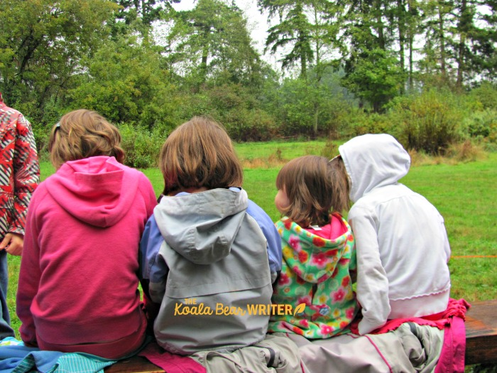 Children watching the birds fly at the Raptors centre in Duncan, BC