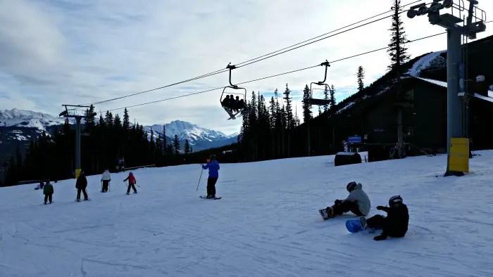 Skiers and snowboarders at Nakiska Ski Resort
