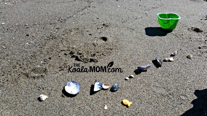 Shells and beach toys on the sand