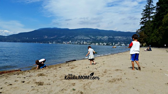 Kids playing at Third Beach in Stanley Park