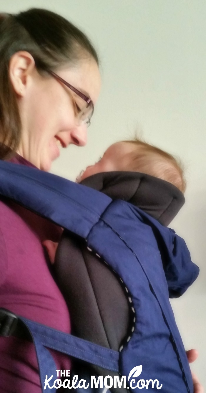 Bonnie Way carrying her baby in the Juno baby carrier by Mountain Buggy