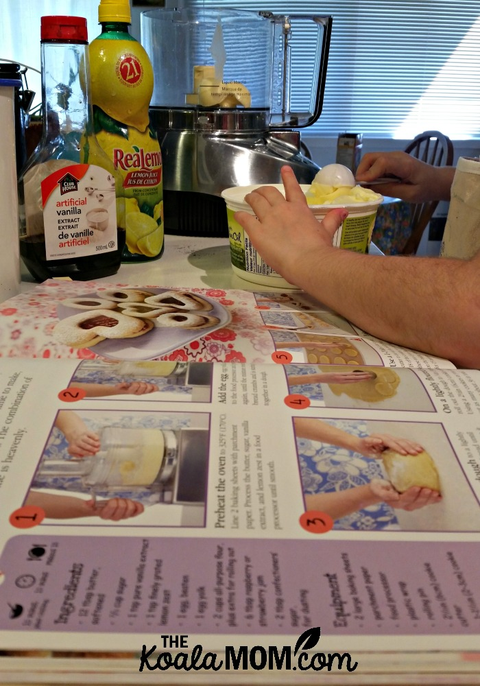 Sunshine bakes cookies with the Complete Children's Cookbook from DK Canada