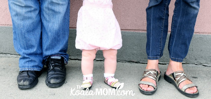 Mommy and Daddy with baby between (just their feet) - photo by Memotime Photography