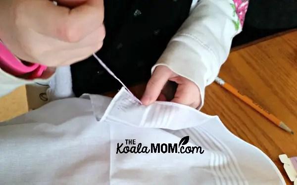 Sunshine embroidering her handkerchief