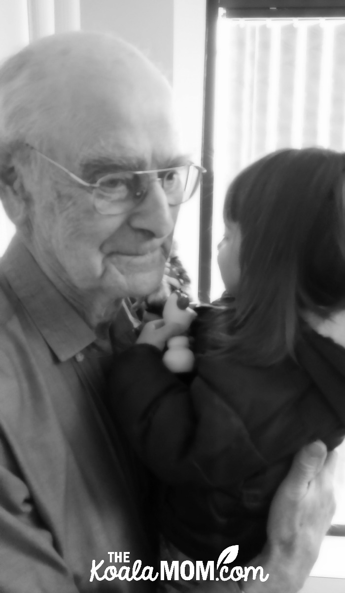 Grandpa holding his great-granddaughter: grandpa's legacy is the importance of family