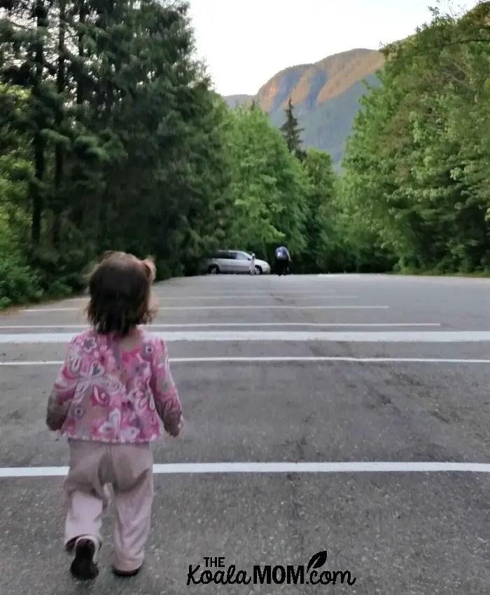 Toddler walking down the Buntzen Lake Parking Lot