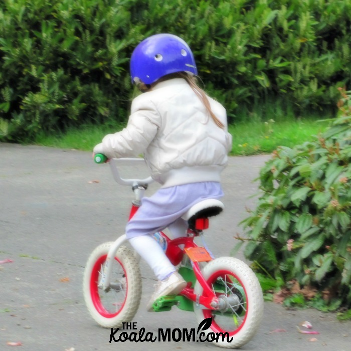 Sunshine as a toddler riding her bike