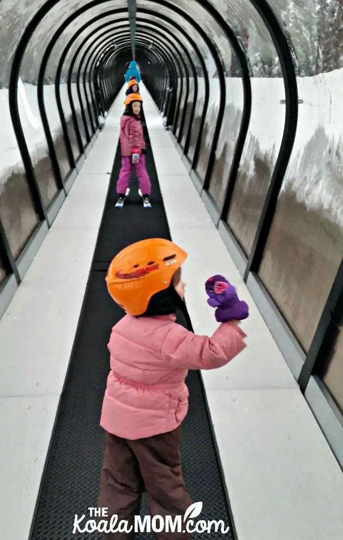 My three girls riding the magic carpet at the ski hill.