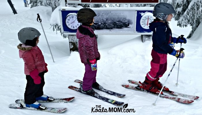 Sunshine, Lily and Jade on their downhill skis at the ski hill.