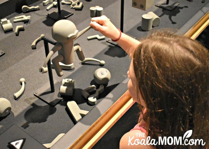 Sunshine builds a robot in the Science Behind Pixar exhibit at Telus World of Science.