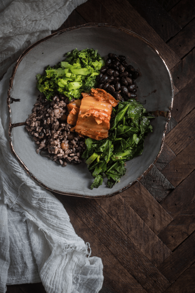 beans,rice, broccoli, collard greens on plate with gold trim