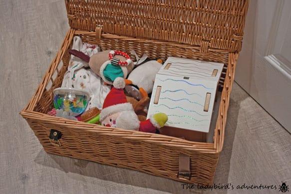 A Christmas box and elf on the shelf