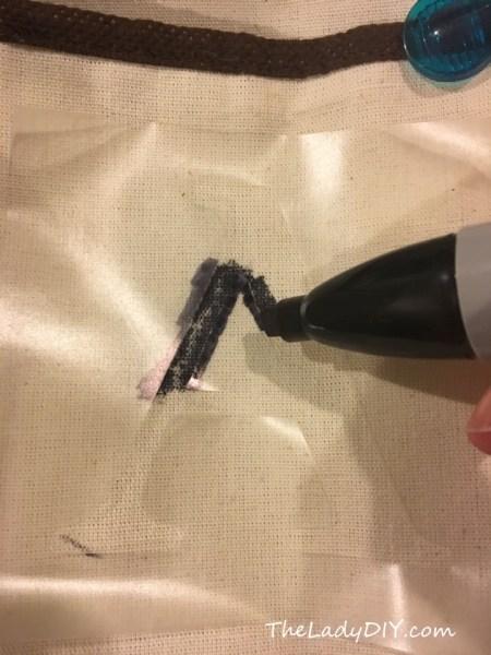 Adding a stencil to the shoe organizer, step 1