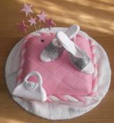 Pillow cake with sugar decorated items used as toppers