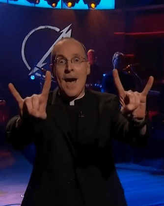 Fr. Martin displaying devil horns