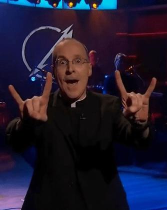Fr. Martin displaying devil horns