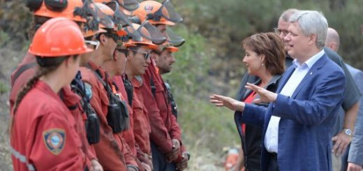 CORRECTED VERSION - CORRECTS DAY OF WEEK - B.C. Premier Christy Clark and Prime Minister Stephen Harper talk with firefighters near the scene of a wild fire in West Kelowna, B.C. Thursday, July 23, 2015. THE CANADIAN PRESS/Jonathan Hayward