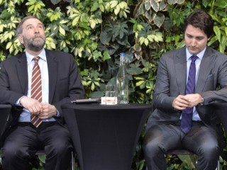 """NDP Leader Tom Mulcair and Liberal Leader Justin Trudeau attend a panel discussion at the """"iVote - jeVote"""" event in Ottawa, Tuesday March 25, 2014. THE CANADIAN PRESS/Adrian Wyld"""