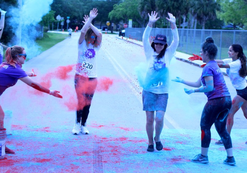 Principal Wendy Doll and Assistant Principal Vera Perkóvic run through students throwing chalk. Photo by Karina Blodnieks