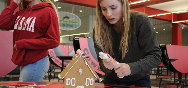 DECA brings gingerbread decorating party to CCHS