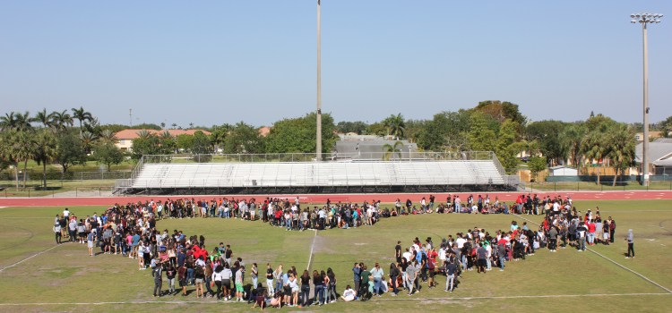 Students walk out, form heart on field in memory of Columbine