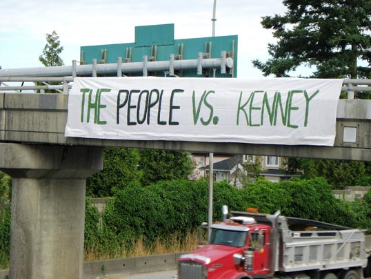 Signage protesting Minister of Immigration Jason Kenney - photo by Tim Reinert