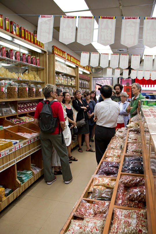 Salt Walk participants stop inside a traditional Chinese medicine shop.|Photo courtesy of Randy Lee Cutler