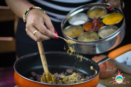Raj Thandhi from Pink Chai Living demonstrating a popular Indian recipe.| Photos courtesy of Pink Chai Living