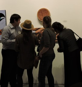 Opening reception of the exhibit, including 11 of the 16 artists. | Photo by Stefanie Wysota