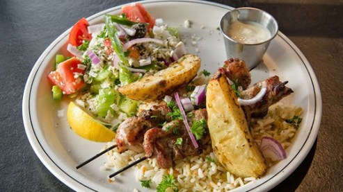 Anatoli Souvlaki makes a dish for Dine Out Vancouver.