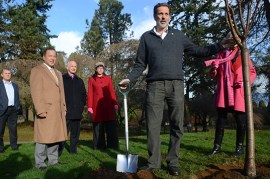 Douglas Justice at a tree planting ceremony at VanDuesen Gardens. | Photo bY Mel Yap
