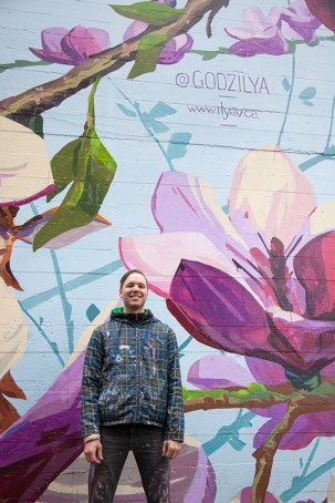 Ilya Viryachev in front of In Bloom: An Ode to Vancouver.| Photo courtesy of Umbrella Pro.