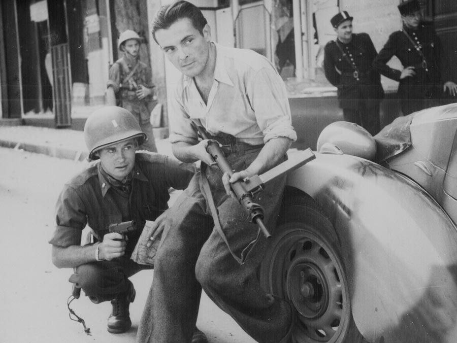 American officer with a French Resistance fighter taking back Paris in 1944.