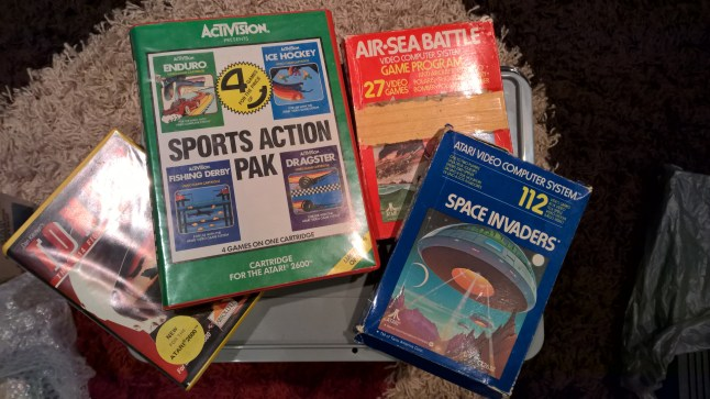 Boxed 2600 cartridges, including Space Invaders and Air Sea Battle.