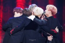 "BTS sharing a sweet group hug after accepting their award of ""Best Album of the Year."" Credit: https://twitter.com/parkjamjam_kr"