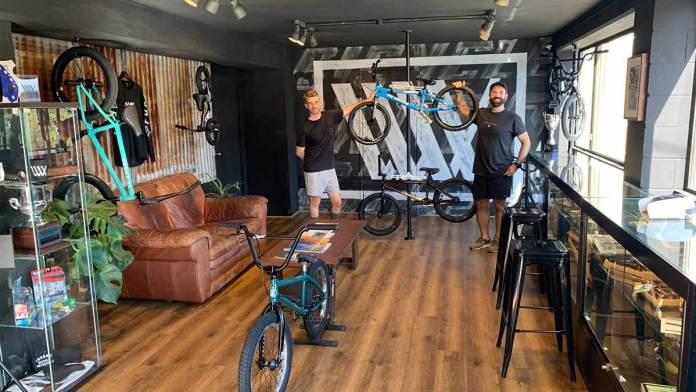 Evan (left) and Mitch in their clubhouse which displays their unique range of carefully selected high end BMX products.