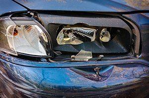 Blue old Car broken front light closeup