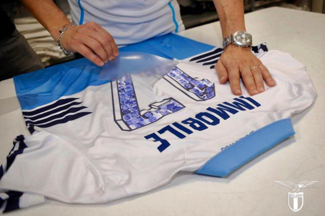 Fans faces printed onto the back of Immobile's kit, Source- Official S.S.Lazio