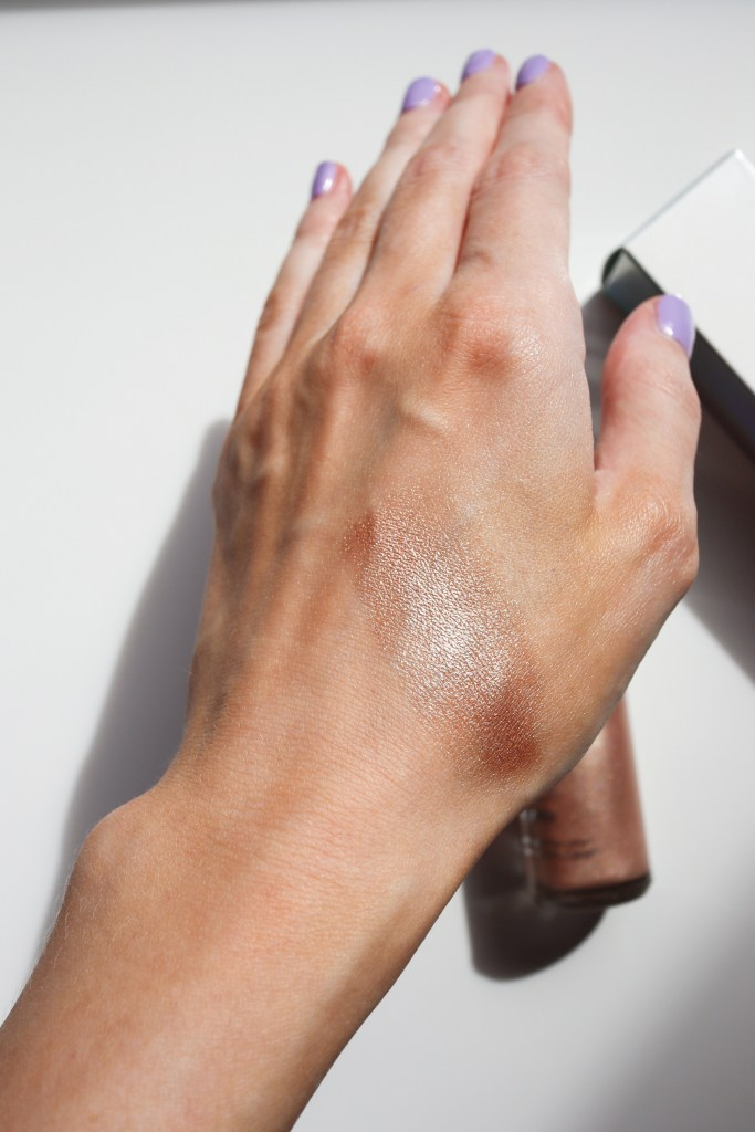 Becca Ignite Liquid Highlighter Swatch Passion