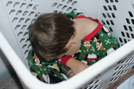 sleeping in a laundry hamper 2