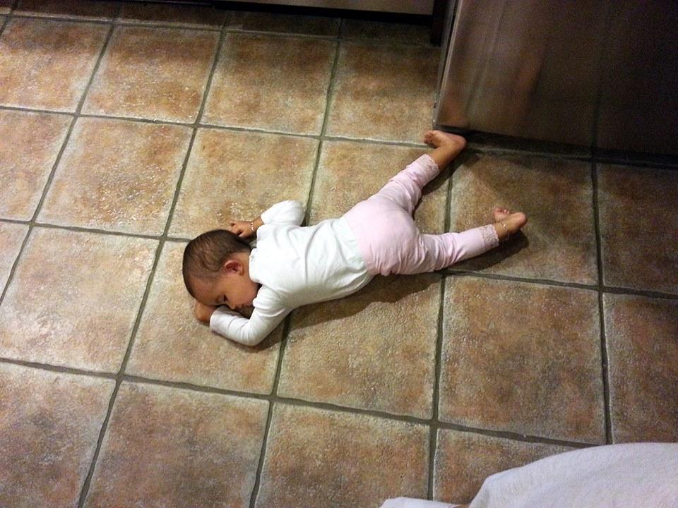 sleeping on the hard tile floor