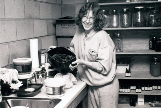 Kathryn, creator of Motherlove, making Green Salve in her kitchen.