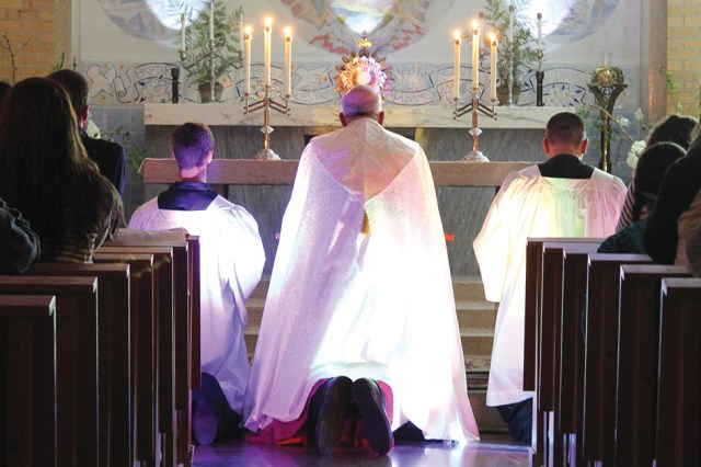 "Archbishop Joseph F. Naumann leads eucharistic adoration during a ""Trust One Greater"" event Nov. 3 on the campus of Benedictine College in Atchison."