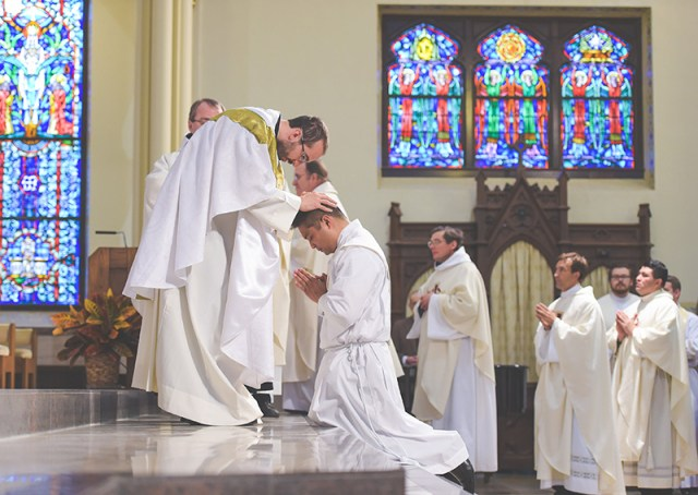 Father Mirco Sosio, AVI, expresses the unity of the presbyterate by imposing his hands on newly ordained Father Gerard Alba. Father Alba was ordained Nov. 15 at the Cathedral of St. Peter in Kansas City, Kansas.