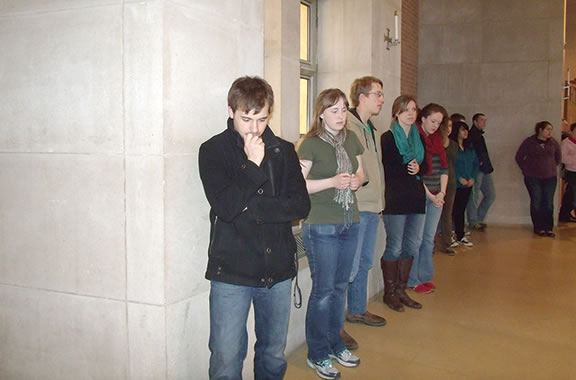 The lines of Benedictine College students waiting to receive the sacrament of reconciliation at St. Benedict's Abbey church in Atchison have grown longer during the Lenten season.